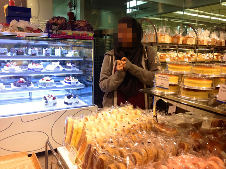 Cousin very happy in a Korean Grocery Store in