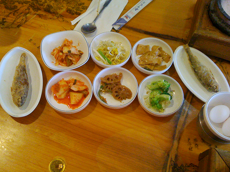 Sides. The batter fried whole fish was awesome. So was the sliced fish, top right. The lotus root is below, center.